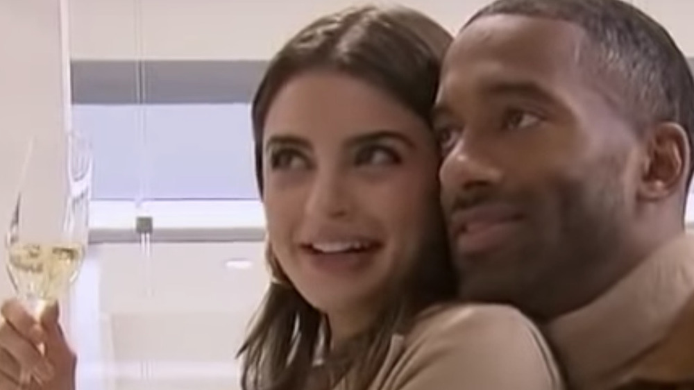 Man and woman hugging at a clothing store
