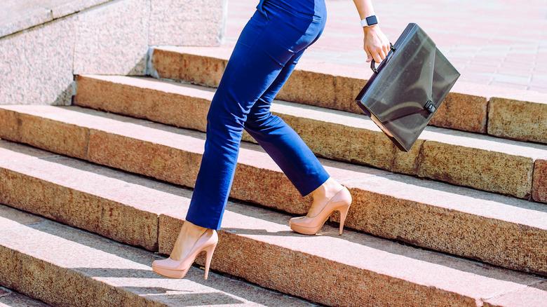 woman walking down stairs in heels