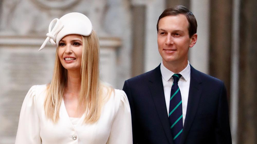 Ivanka Trump in a white hat with Jared Kushner