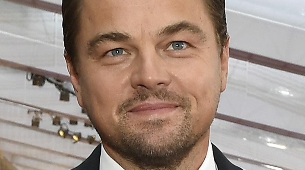 Leonardo DiCaprio smiles in a tuxedo