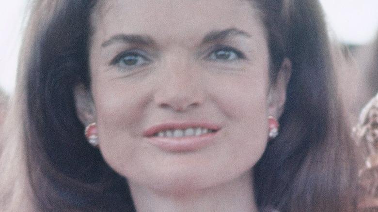 Jacqueline Kennedy Onassis smiling