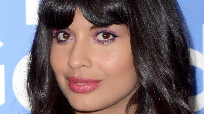 Jameela Jamil smiles with bangs