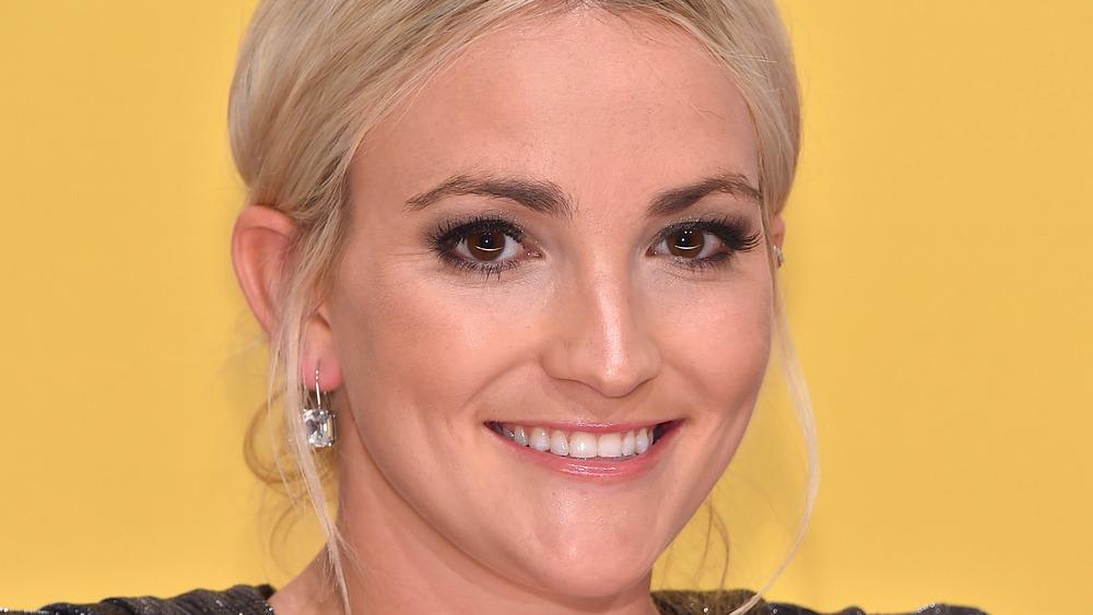 Jamie Lynn Spears hair up smiling with diamond earrings