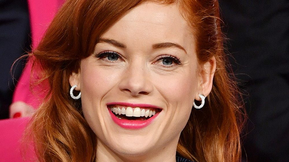 Jane Levy smiling with delicate earrings