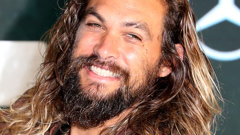 Jason Momoa smiles