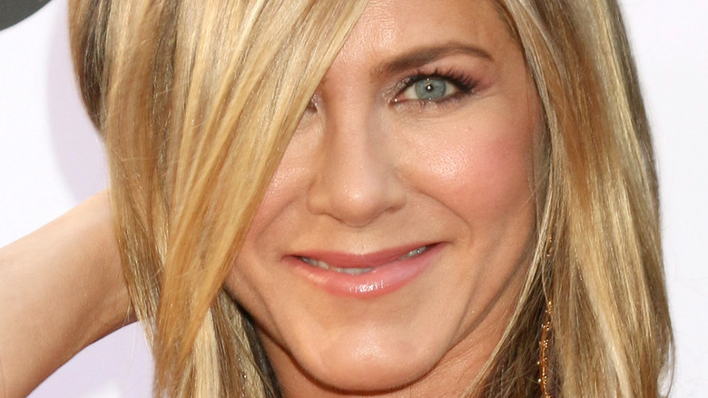 Jennifer Aniston plays with her hair