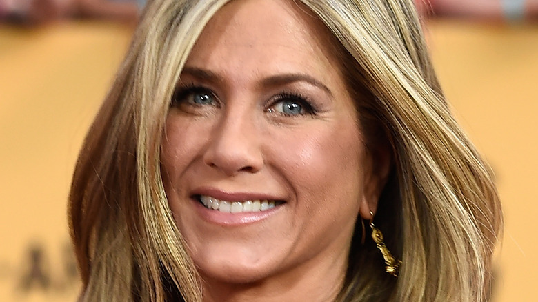 Jennifer Aniston smiles at an event.