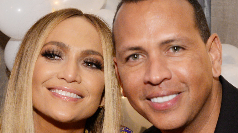 Jennifer Lopez and Alex Rodriguez smiling at event