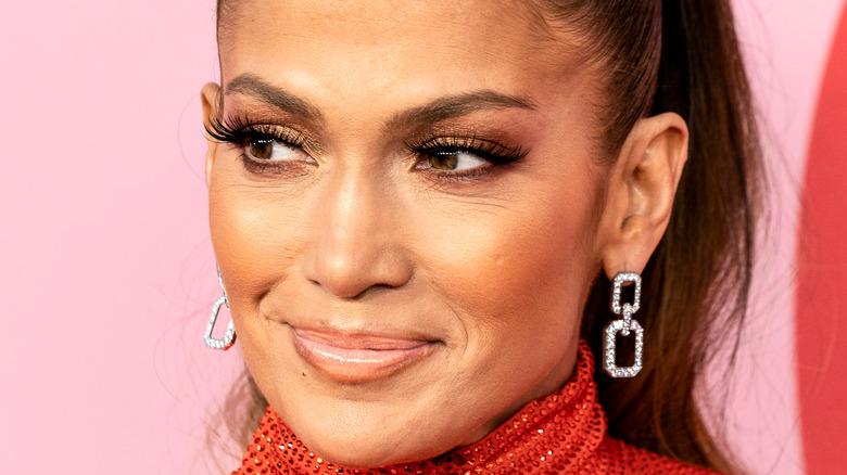 Jennifer Lopez smiles on the red carpet.