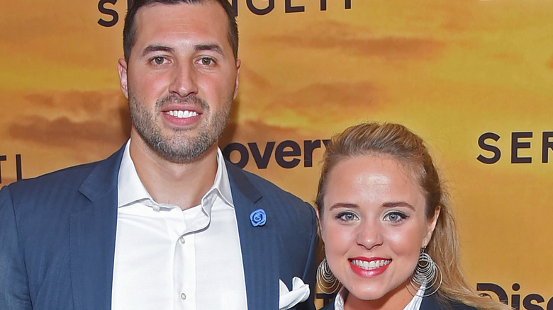 Jeremy and Jinger Vuolo smiling on red carpet