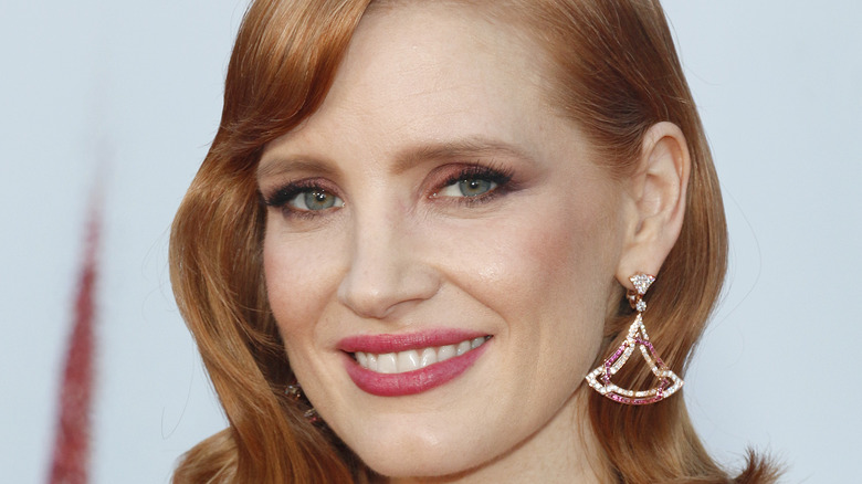 Jessica Chastain smiling on red carpet