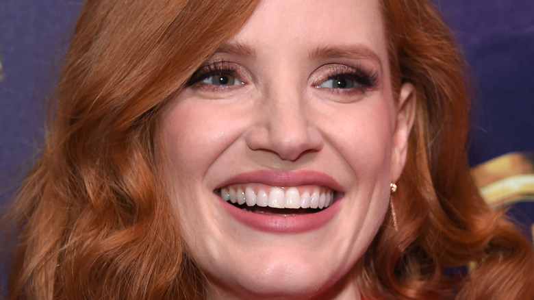Jessica Chastain smiling while having her picture taken