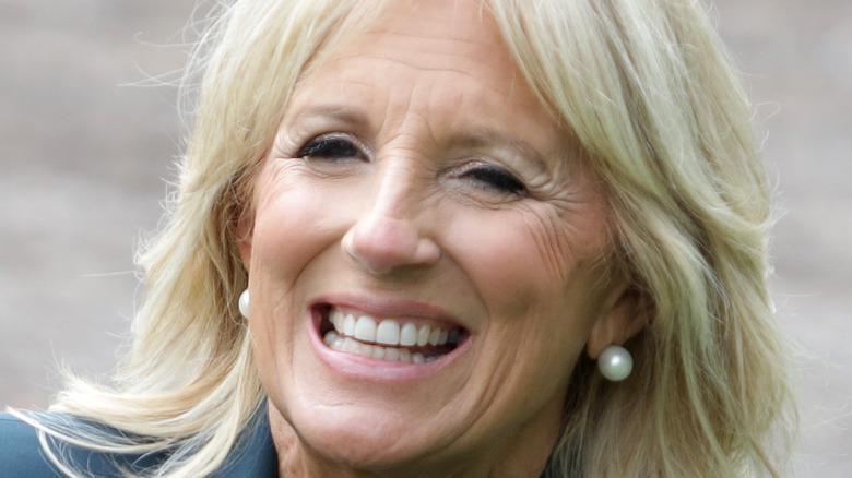 Jill Biden smiling wearing pearls