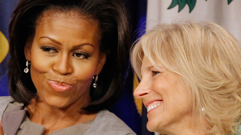 Jill Biden and Michelle Obama smiling together