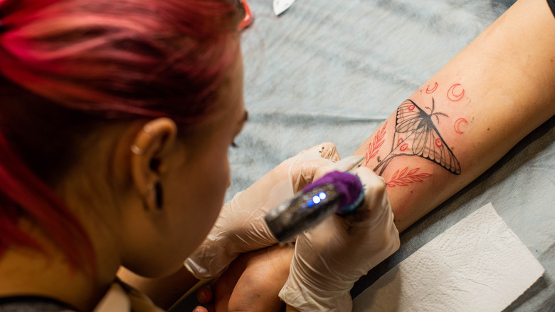 woman with tattoos