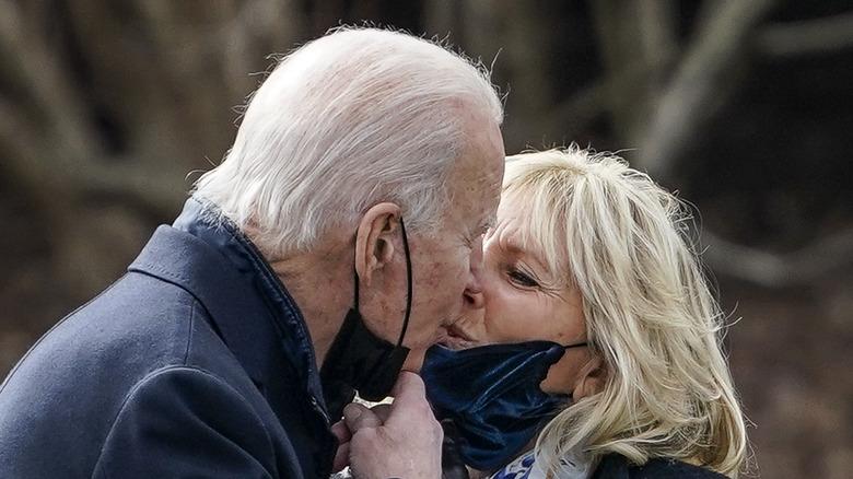 President Joe and Jill Biden sharing a kiss outside