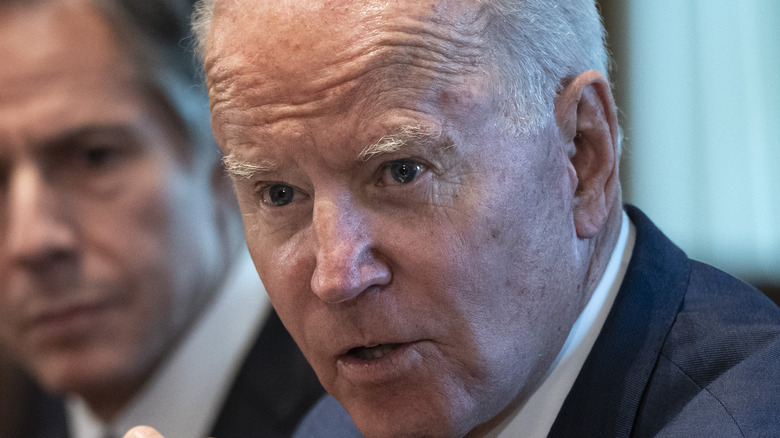 Joe Biden sitting next to Tony Blinken