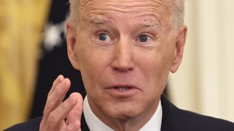 Biden talking to a reporter