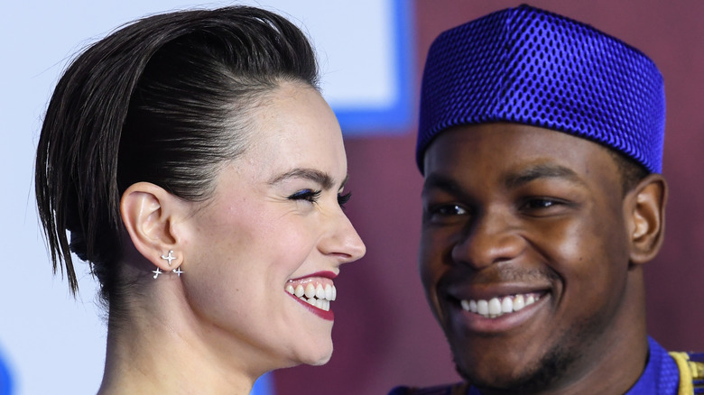 John Boyega and Daisy Ridley smiling