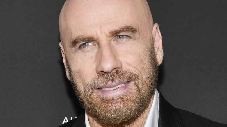 John Travolta smiling with facial hair