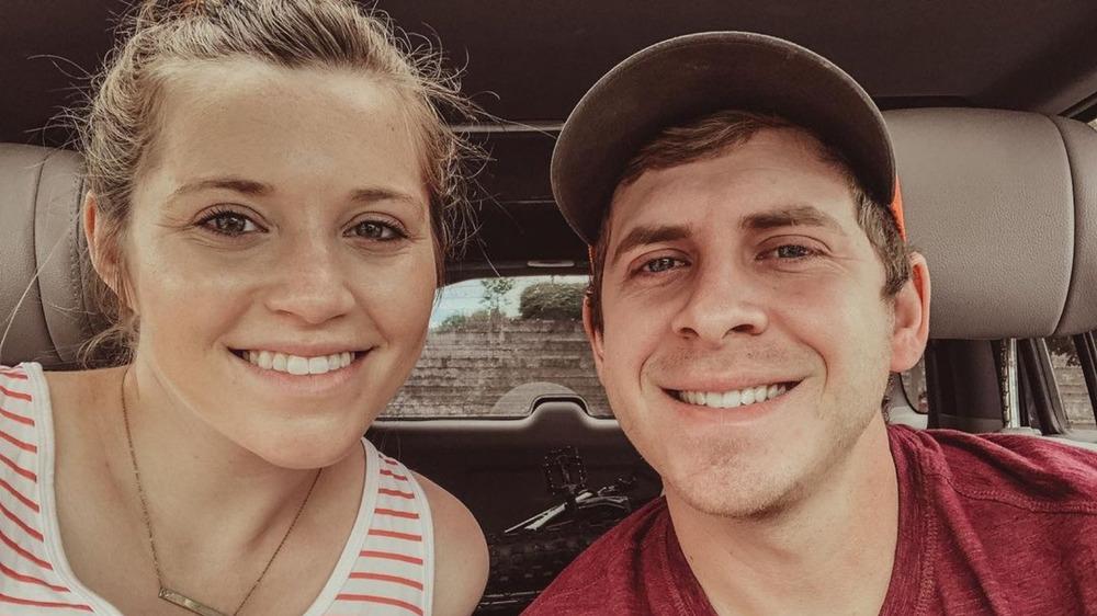 Joy Anna and Austin Duggar smiling inside car
