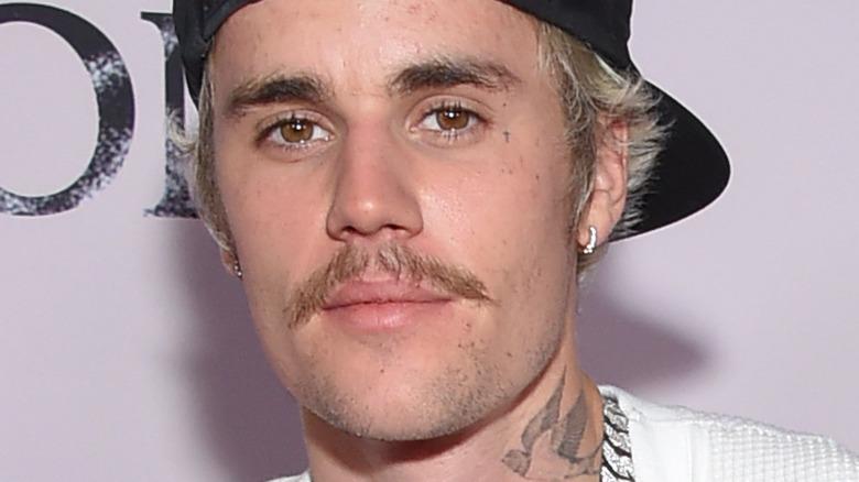 Justin Bieber posing at an event