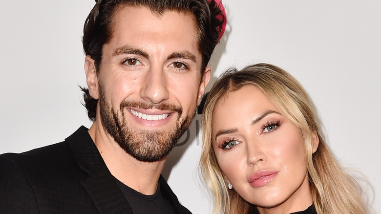 Kaitlyn Bristowe and Jason Tartick smile at red carpet event