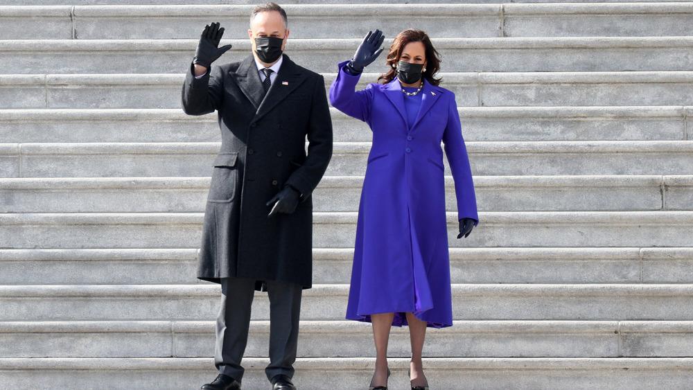 Kamala Harris and Doug Emhoff waving in masks