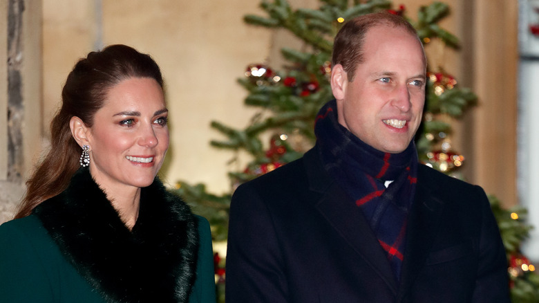 Kate Middleton and Prince William in front of Christmas tree