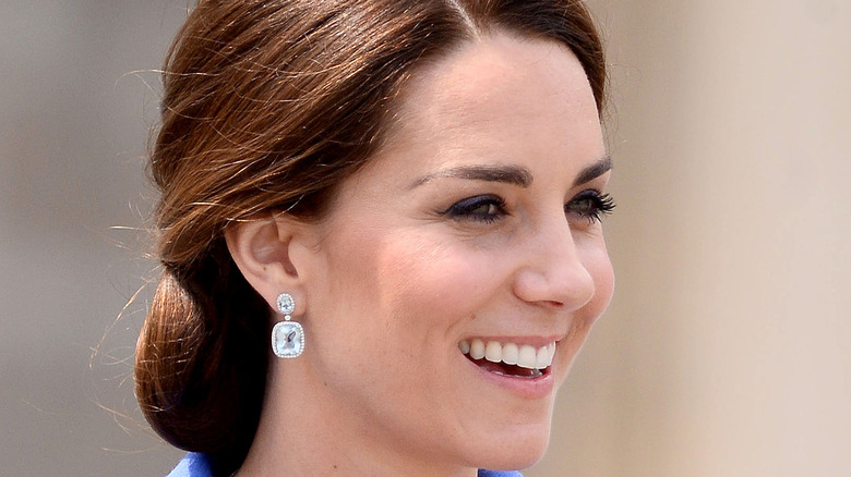 Kate Middleton smiles for photographers
