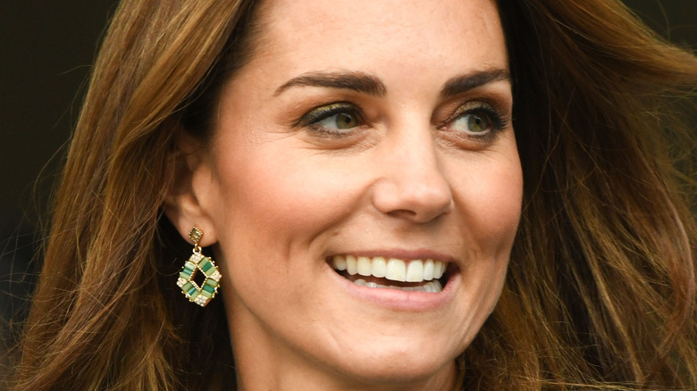 Kate Middleton smiles at an event.