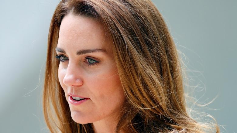 Kate Middleton wears a pink blazer.