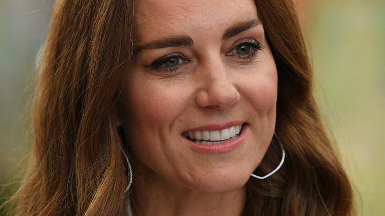 Kate Middleton smiling outside