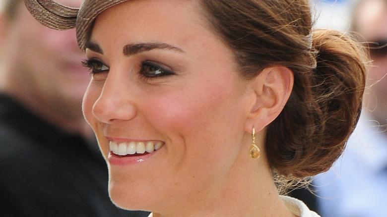 Kate Middleton smiling in fascinator