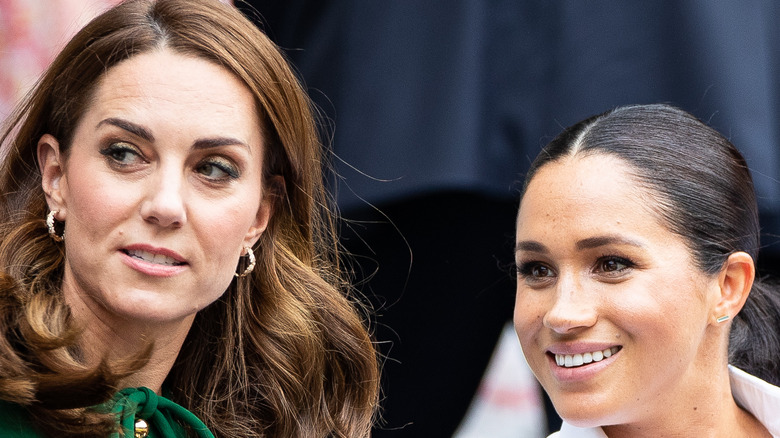 Kate Middleton and Meghan Markle at tennis event