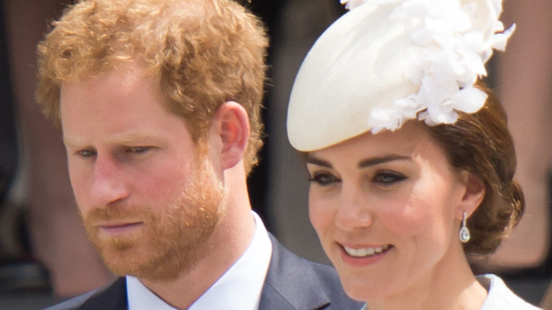 Prince Harry with Kate Middleton.
