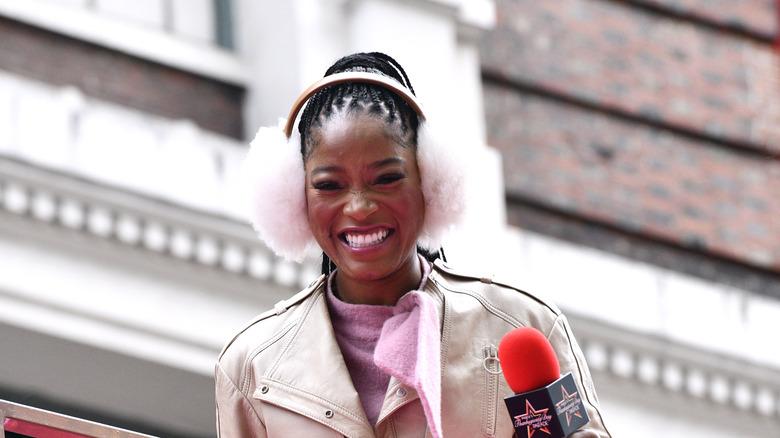Keke Palmer in pink earmuffs