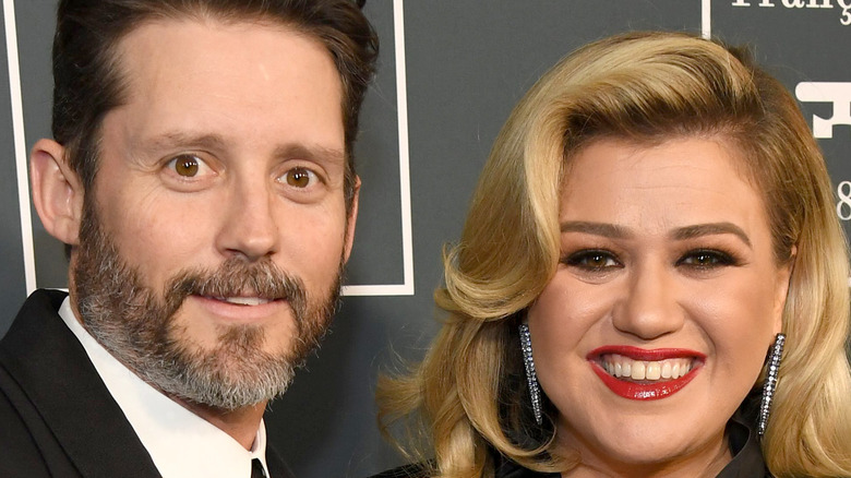 Kelly Clarkson and Brandon Blackstock at an event.