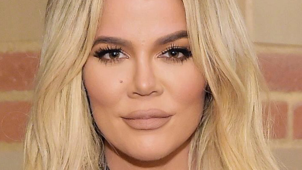 Khloé Kardashian grinning hair down