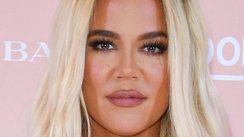 Khloe Kardashian posing with blonde hair
