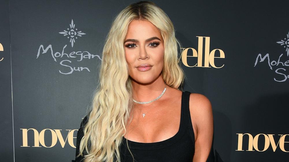 Khloe Kardashian red carpet pose
