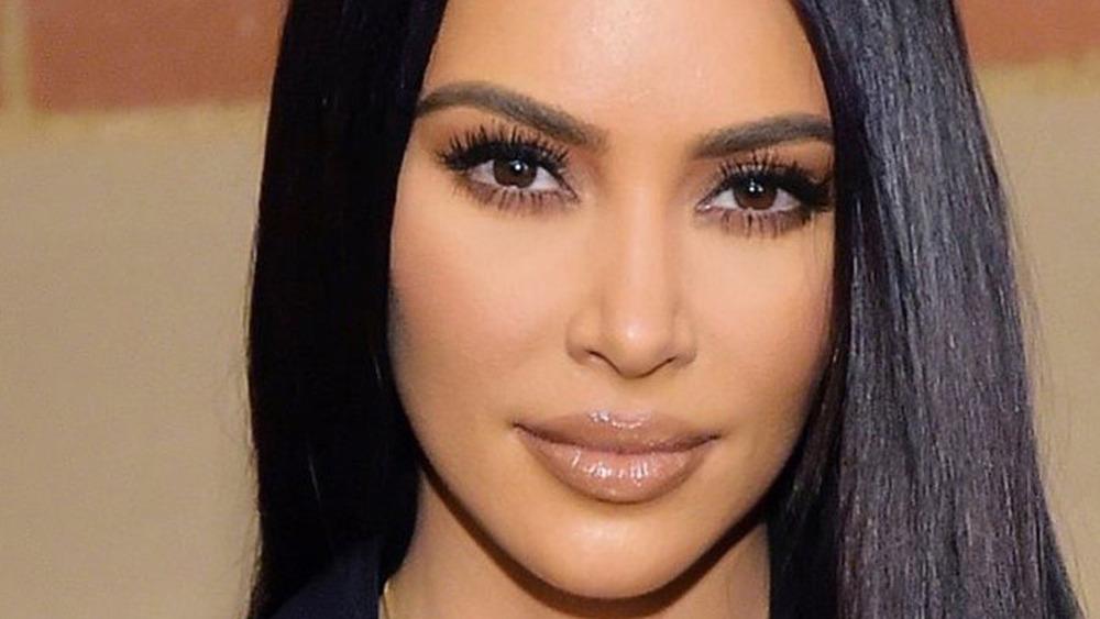 Kim Kardashian slight grin hair down