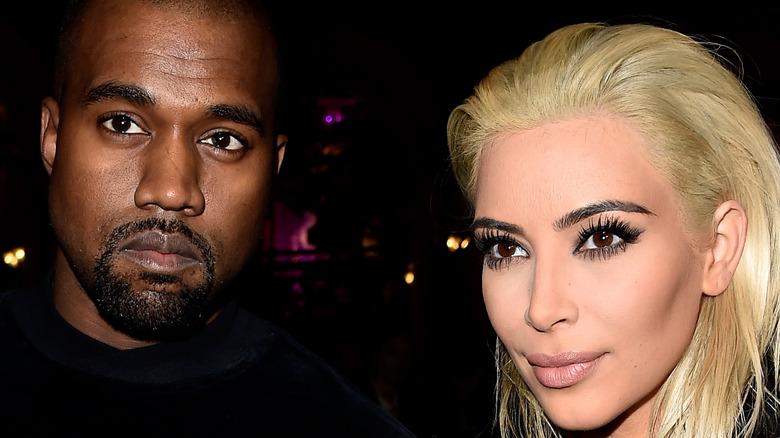 Kanye West and Kim Kardashian posing