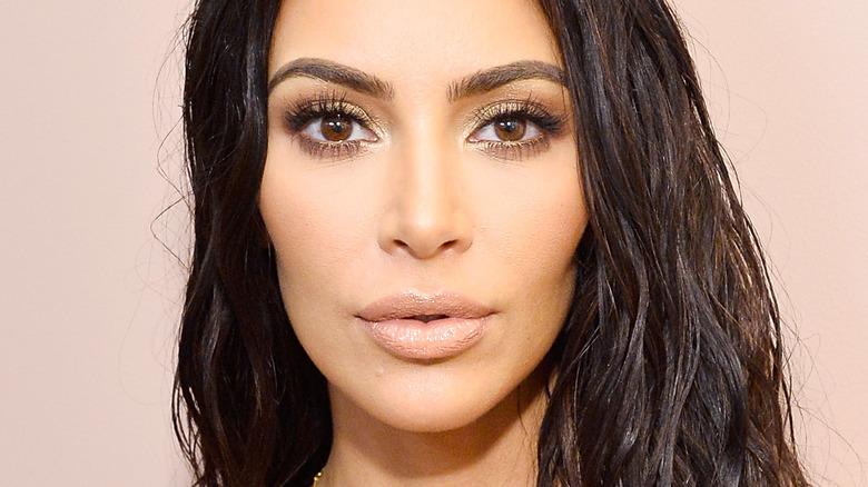 Kim Kardashian with serious expression and nude lipstick