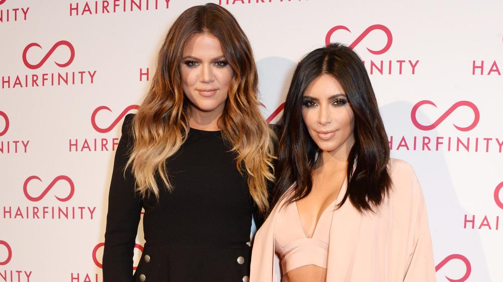 Kim Kardashian Khloe Kardashian posing