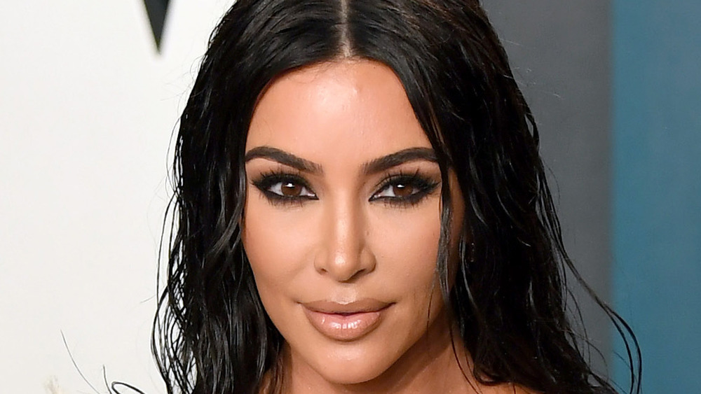 Kim Kardashian with middle part at an event