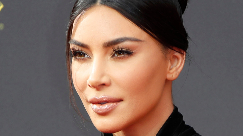Kim Kardashian in profile with her hair up