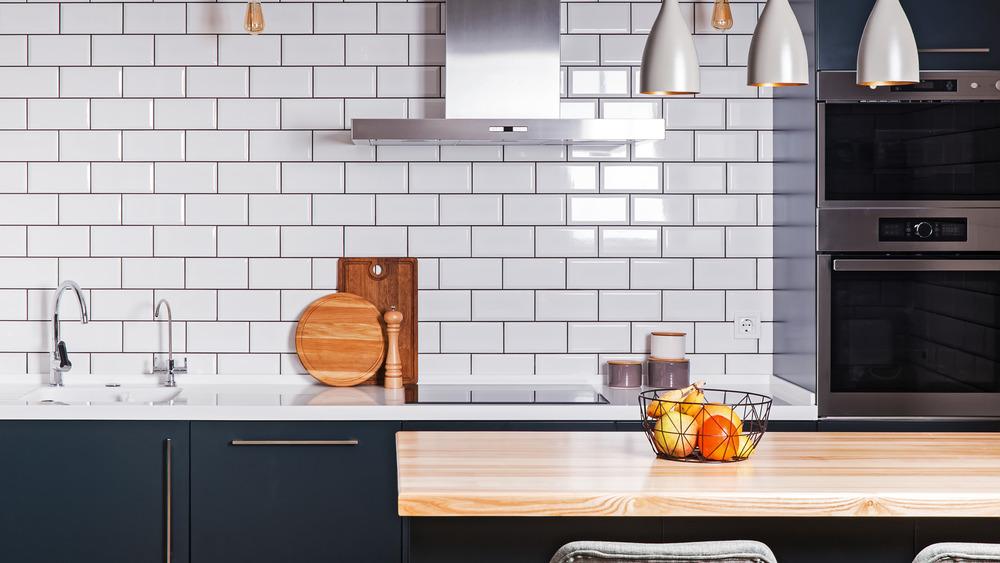Navy blue kitchen cabinets, white subway tile