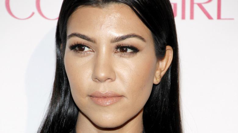 Kourtney Kardashian posing on red carpet