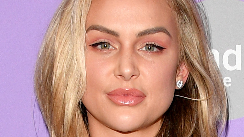 Lala Kent shows off her plump lips and wears diamond earrings.